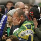 Supporters in the fan zone in Belfast and Basel show their frustration last night