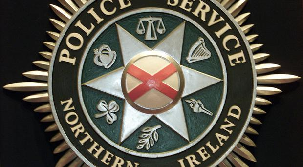 A man has been assaulted by three men in a black Mercedes in west Belfast.
