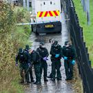 Police search the area close to the pedestrian tunnel under Madam's Bank Road in Londonderry where a man was shot