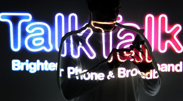 Shares in TalkTalk have slumped after the telecoms group dived to a half-year loss and warned over profits as it took a hit from efforts to secure more customers