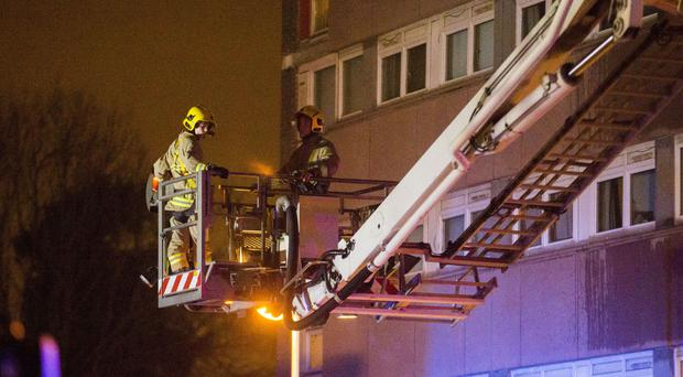Four injured after fire at Belfast tower block