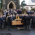 The funeral of Northern Ireland Ploughing Association chairman Wilson Holden at Gardenmore Presbyterian Church in Larne yesterday