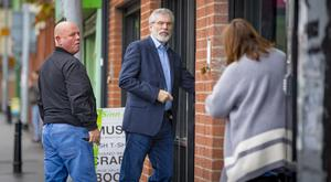 Gerry Adams arrives at the West Belfast constituency offices yesterday