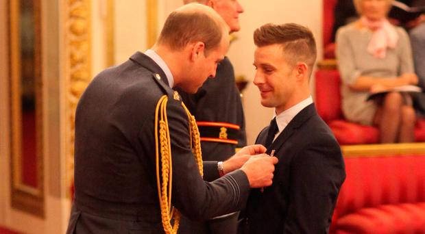 Jonathan Rea is made an MBE by the Duke of Cambridge at Buckingham Palace yesterday