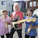 Brian Bennett with Patricia McCabe (left) and Charmain Geehan, from the NI Hospice, with some of the 19 Fender Stratocaster guitars Brian has donated to the charity