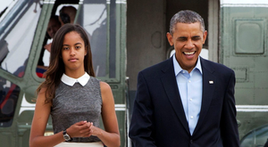 Malia Obama with her father Barack in 2014 when he was US President