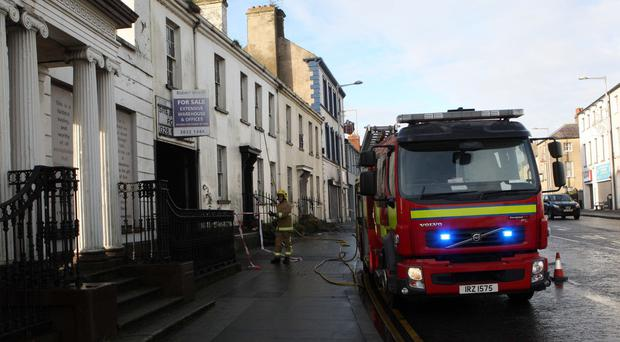 Firefighters attend the scene of the blaze in Lurgan yesterday