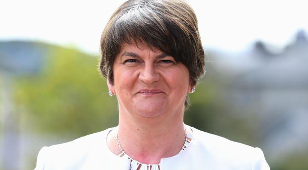 Arlene Foster joked that the gaffe might have cost her an invite to the royal wedding