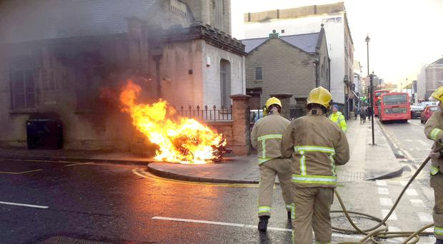 Fire crews extinguish a street sweeper which caught fire in Londonderry city centre yesterday