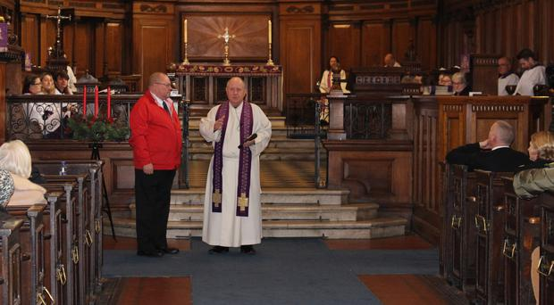 Bomb survivor Neil Tattersall and Rev Nigel Ashworth at the service to mark the anniversary of the Manchester bombings