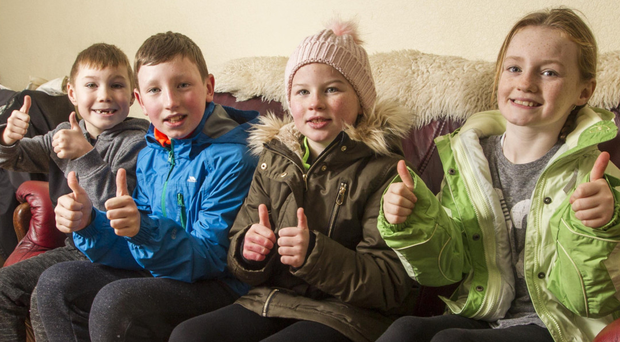 From left: Siblings Ryan, John and Saoirse Gray with friend Cody Donegan celebrate moving in to the temporary home