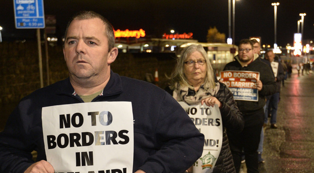 Supporters of Sinn Fein's stance protest on Belfast's Andersonstown Road