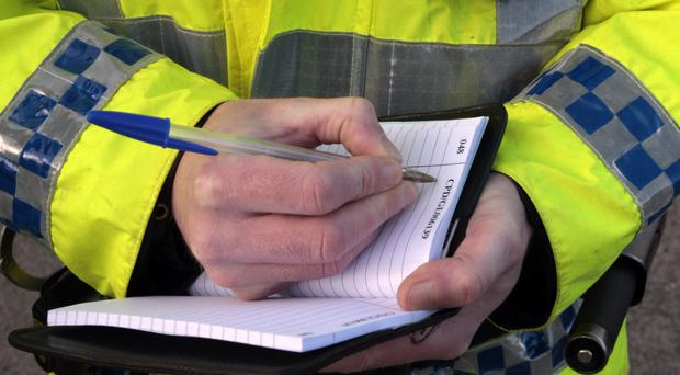 The police officers were arrested in Co Antrim