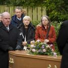 Mourners at the funeral of artist Joy Clements yesterday