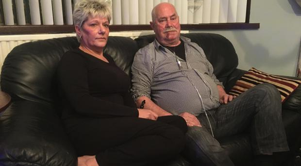 Ken Wilkinson and Eileen Mathieson recover at their Antrim home yesterday