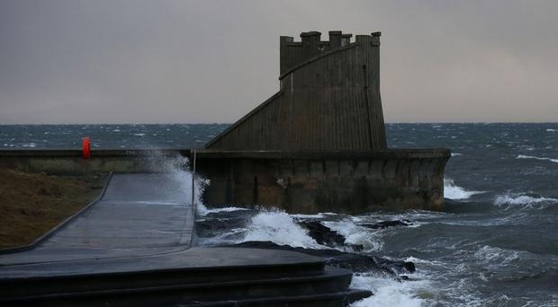 Stormy seas near Saltcoats, North Ayrshire, as severe gales and snow showers cause travel disruption, school closures and power cuts