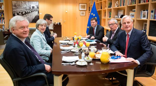 British Prime Minister Theresa May, Brexit Minister David Davis (left) and EU President Jean-Claude Juncker (second right) having a working breakfast at the EU Commission in Brussels