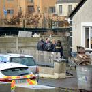 Gardai at the scene of the gun attack yesterday