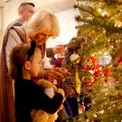 The Duchess of Cornwall with children from Helen & Douglas House and Roald Dahl's Marvellous Children's Charity decorating the Clarence House Christmas tree yesterday