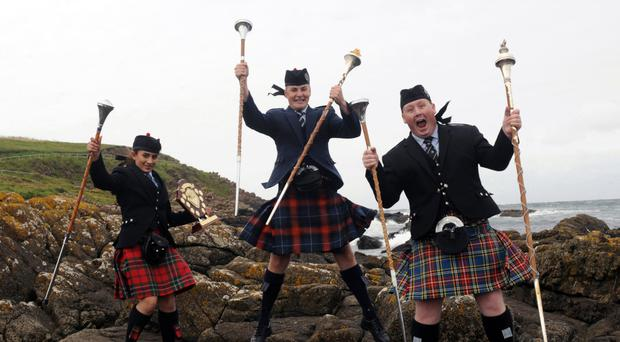 World Champion Drum Majors - Rachel Lowry, Armaghbreague Pipe Band (Junior Grade), James Kennedy, Closkelt Pipe Band (Juvenile Grade) and Jason Price, Ravara Pipe Band (Adult Grade) pictured at the North West Pipe Band & Drum Major Championships at Ramore Head,