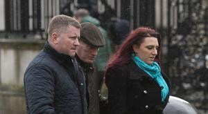 Britain First leader Paul Golding (left) and deputy Jayda Fransen (right) arrive at court in Belfast where she faces charges over an alleged hate speech in the city in August
