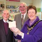 The Mayor of Causeway Coast and Glens Borough Council, Councillor Joan Baird OBE, holds the tiny pocket bible as Steven Chambers, Ernest Crawford and Laurence Chambers look on