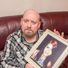 Paul Loughrey holds a picture of daughter Amy, who died last December
