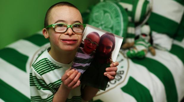 Celtic fan Jay Beatty holding picture of him and former Hoops star Georgios Samaras.
