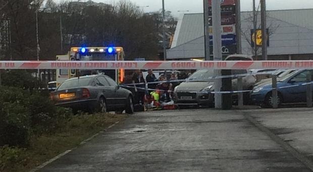 Emergency services at the scene of the accident in Larne town centre yesterday, in which a woman in her 50s died