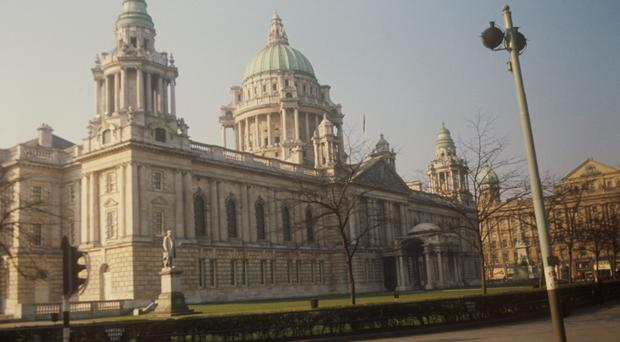 Three people have now been charged in connection with the rally outside Belfast City Hall
