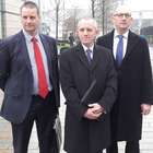 From left: John Martin, RHANI executive chair Andrew Trimble and Tom Forgrave outside the court in Belfast