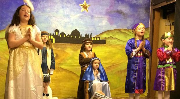 The pupils of St Mary's Primary School on Rathlin Island perform on stage for family and friends