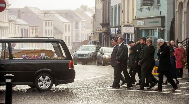 The funeral cortege of Carolyn Hicks leaves St Michael's Church