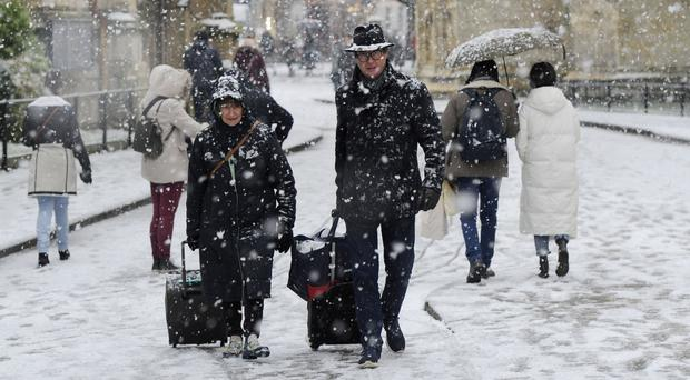 People walk through the snow in York