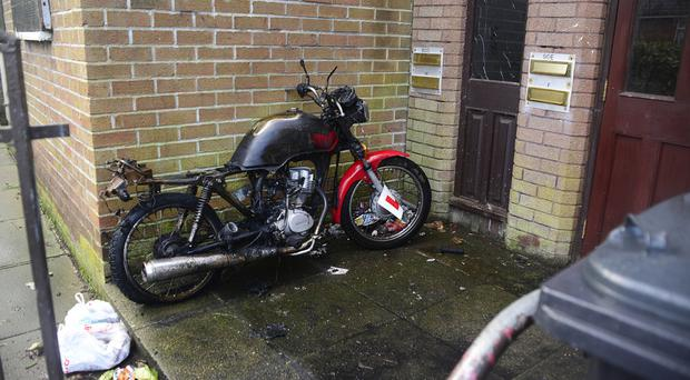 The motorcycle that was set alight in the communal hallway at the Ardoyne Road flats