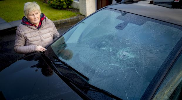 Lorraine McBride with her damaged car in Newtownabbey