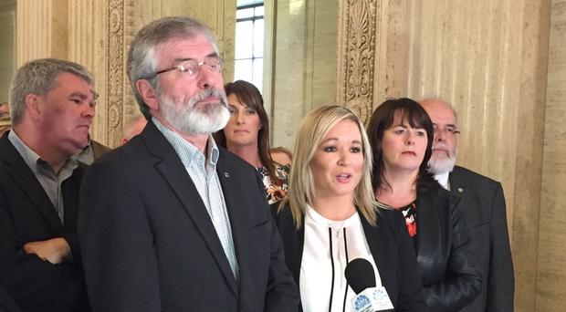 Sinn Fein's party president Gerry Adams, seen here with Northern Ireland leader Michelle O'Neill, has criticised the DUP's pro-Brexit stance