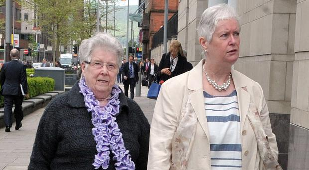 May Quinn (left) pictured attending the Kingsmill inquest in Belfast in 2016, along with Shirley Leeman