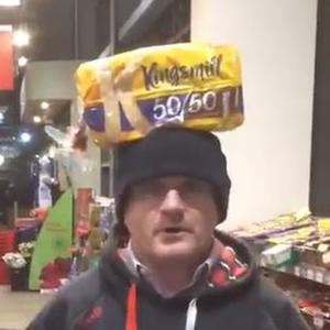Barry McElduff with a Kingsmill-branded loaf on his head