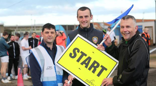 Coleraine FC manager Oran Kearney starts the Magilligan Prison parkrun with organiser Colin Rice (left), and Gary Milling, Magilligan Prison Governor