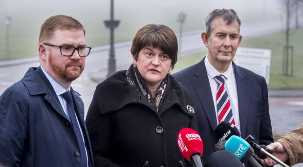 DUP leader Arlene Foster, with colleagues Simon Hamilton and Edwin Poots (right), speak with the media after talks with new Secretary of State for Northern Ireland Karen Bradley