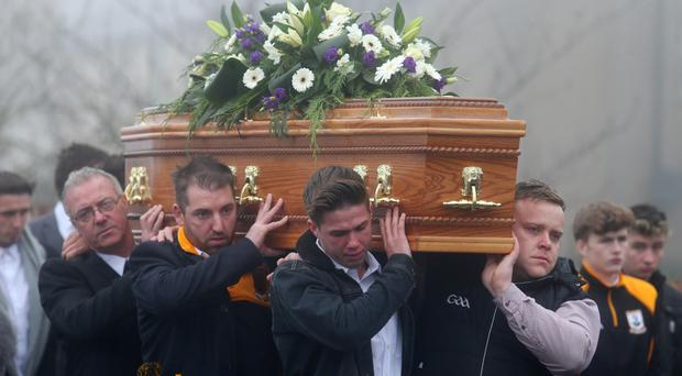 Mourners carry the coffin of father-of-two Christopher Colhoun in Clonoe, Co Tyrone, yesterday