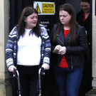 Teresa White (left) leaves the inquest yesterday
