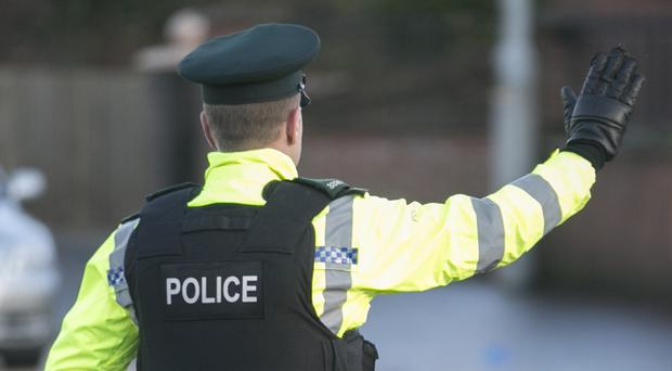 PSNI officers urged witnesses to come forward after a gun attack on a house