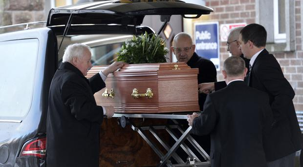 The funeral of cricket journalist David Holmes yesterday was attended by a large gathering of friends, family and sporting colleagues