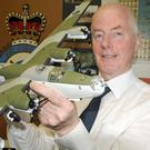 Norman Thorpe, secretary of the Shackleton Museum at Magilligan Point, with a model of a Liberator which was stationed at Ballykelly barracks
