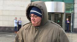 Paul Rimmer leaves Belfast Magistrates' Court (Lesley-Anne McKeown/PA)