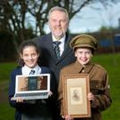 Grange Park PS pupils Molly Reid and Harry Challinor with Robert Robinson MBE, headmaster of Campbell College Belfast