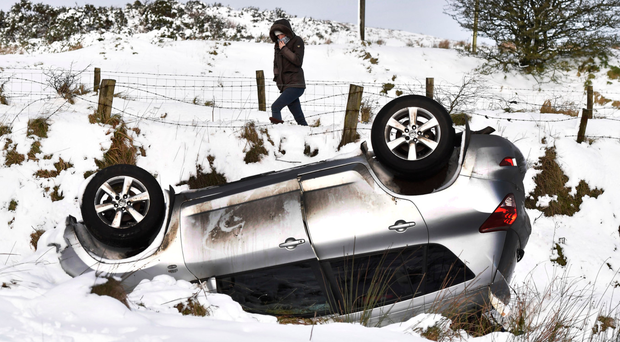 An overturned car just outside Belfast