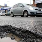 A huge pothole on Belfast's Ravenhill Road.